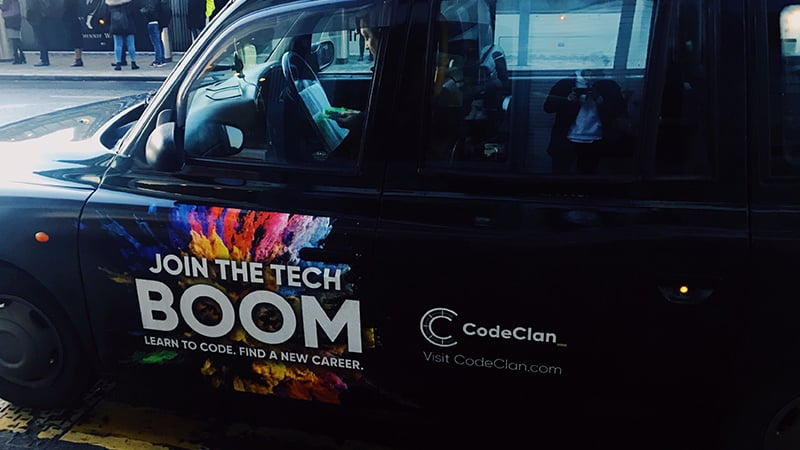 Black taxi with CodeClan 'Tech boom' on the side