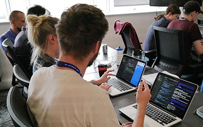 Students learning in front of laptops at CodeClan
