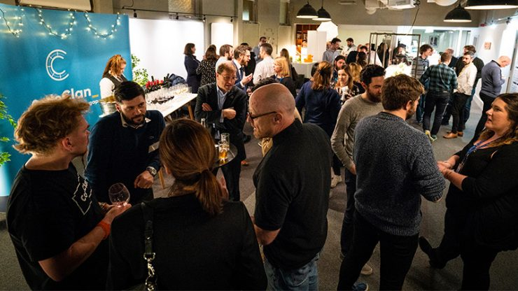 People chatting in groups at a CodeClan event
