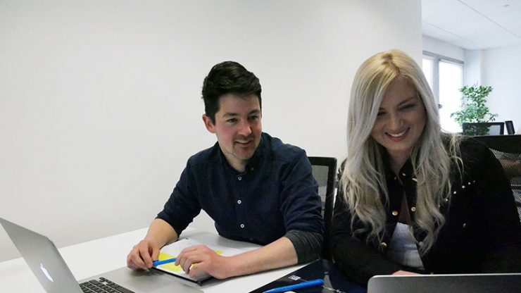User Experience Design students Fiona and Adam sitting in class at CodeClan
