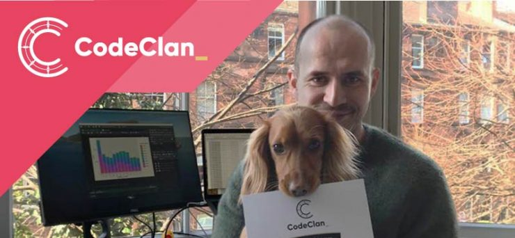 Graham and his dog with his CodeClan certificate